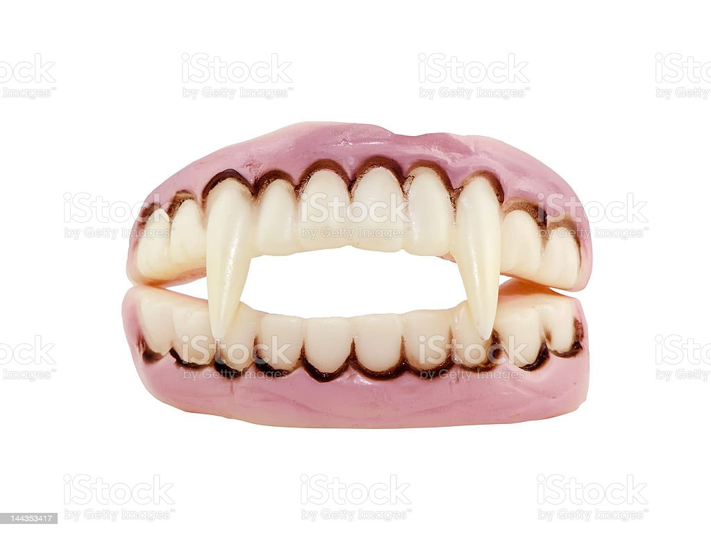 Vampire Teeth Vampire teeth isolated on white Cut Out Stock Photo