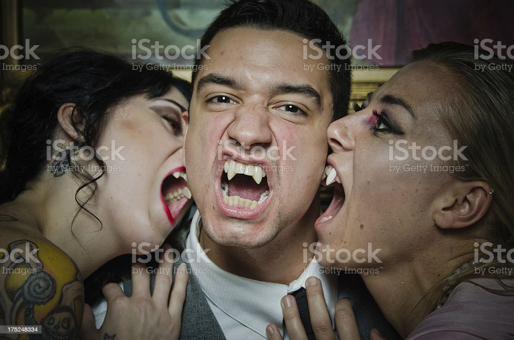 Vampires Showing of Their Fangs stock photo
