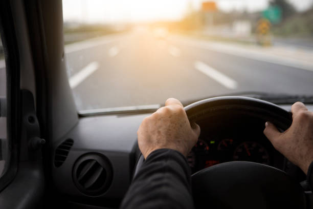 van driver - steering wheel stock photos and pictures