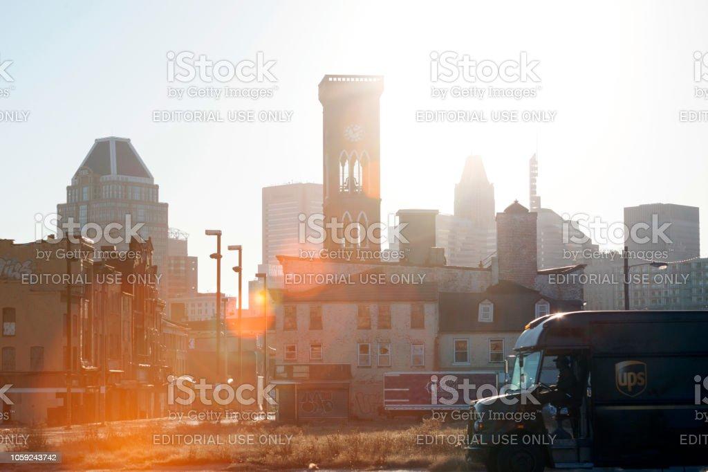 UPS van driving in Old Town neighborhood of Baltimore, Maryland stock photo