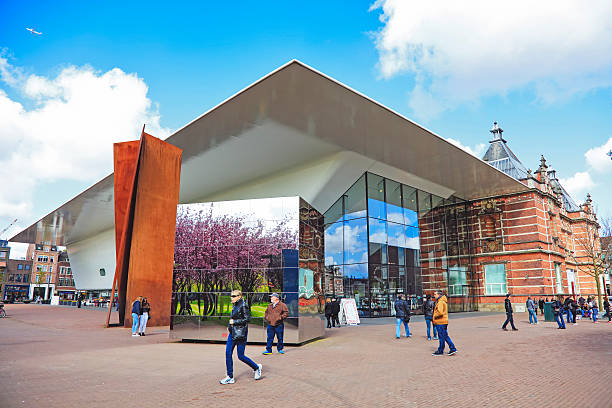 Van Gogh Museum, Amsterdam, Netherlands Amsterdam, Netherlands - May 3, 2016: Van Gogh Museum with people walking. It shows one of the buildings of this museum located on the