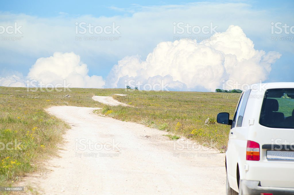 Van on the dirt serpantine road royalty-free stock photo