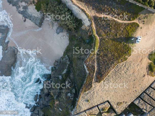 Photo of Van parked at the edge of the cliff by the sea