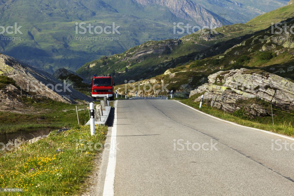 Van parked by road on the ascent to the step stock photo