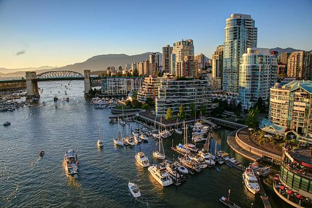 vancouver bc canada cityscape at sunset - vancouver canada stockfoto's en -beelden