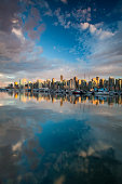 View of Vancouver Canada British Columbia city skyline from Stanley park in the evening