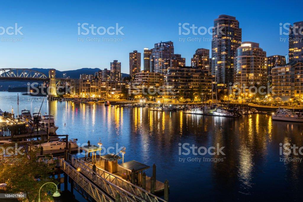 Vancouver city skyline and False Creek at dusk, British Columbia,...