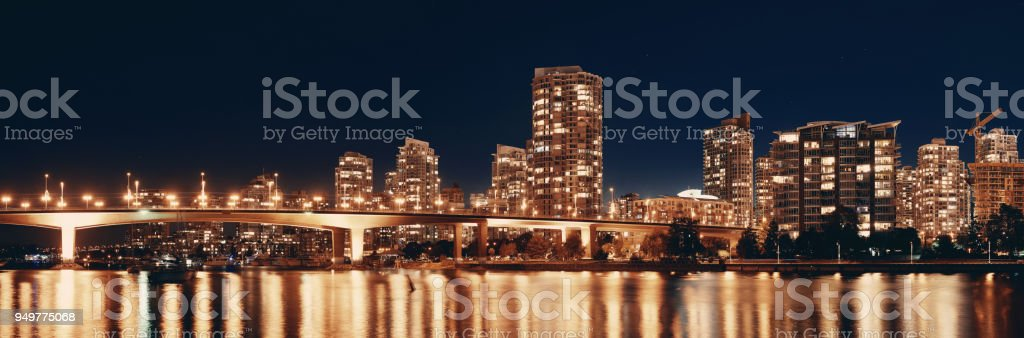 Vancouver city skyline at night view with buildings and bridge.