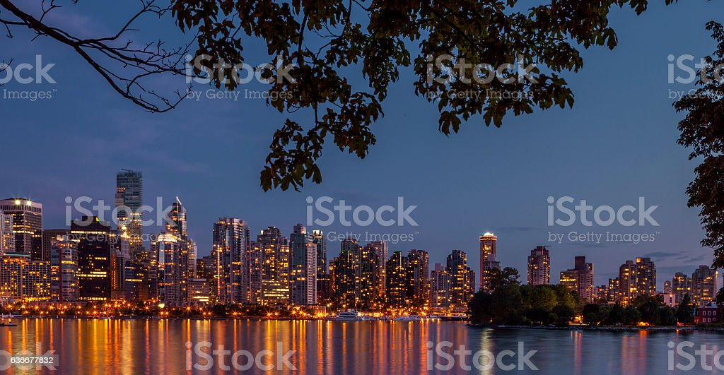 Vancouver office and residential buildings reflecting in water at...