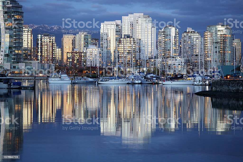 Vancouver City Skyline Reflected in River at Night royalty-free stock photo