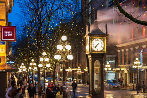 Gastown Steam Clock and downtown beautiful street view on a rainy night. Cambie and Water Street. Vancouver, Canada.