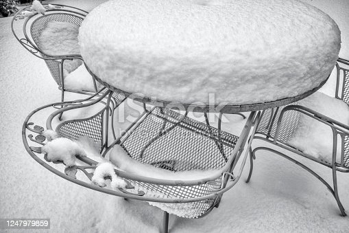 Snow encrusted patio chairs on Vancouver Island, British Columbia