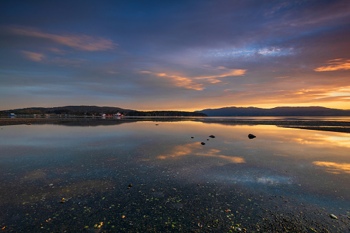 Reflecting sunset over Patricia Bay.