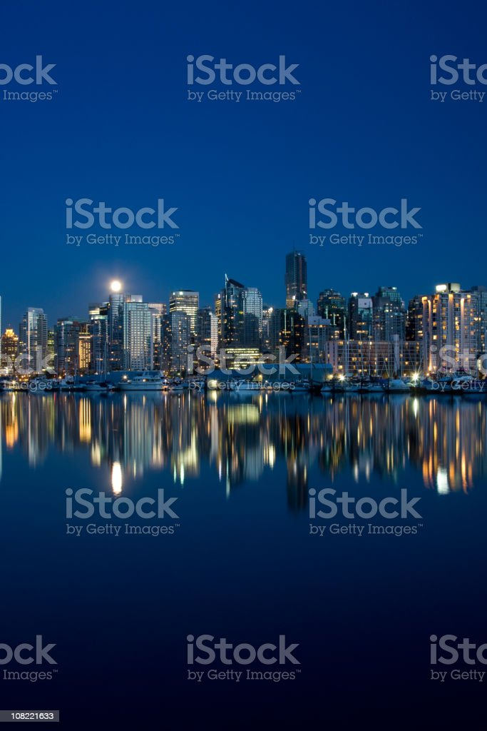 Vancouver Skyline and Reflection on Water at Dusk royalty-free stock photo