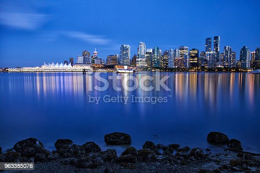Vancouver skyline at blue hour in Stanley park on a Spring evening, long exposure.