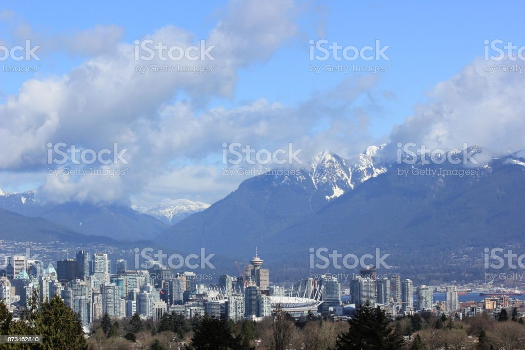 Vancouver skyline - snow capped mountain range from Queen Elizabeth Park, on a Spring morning, Vancouver, Canada stock photo