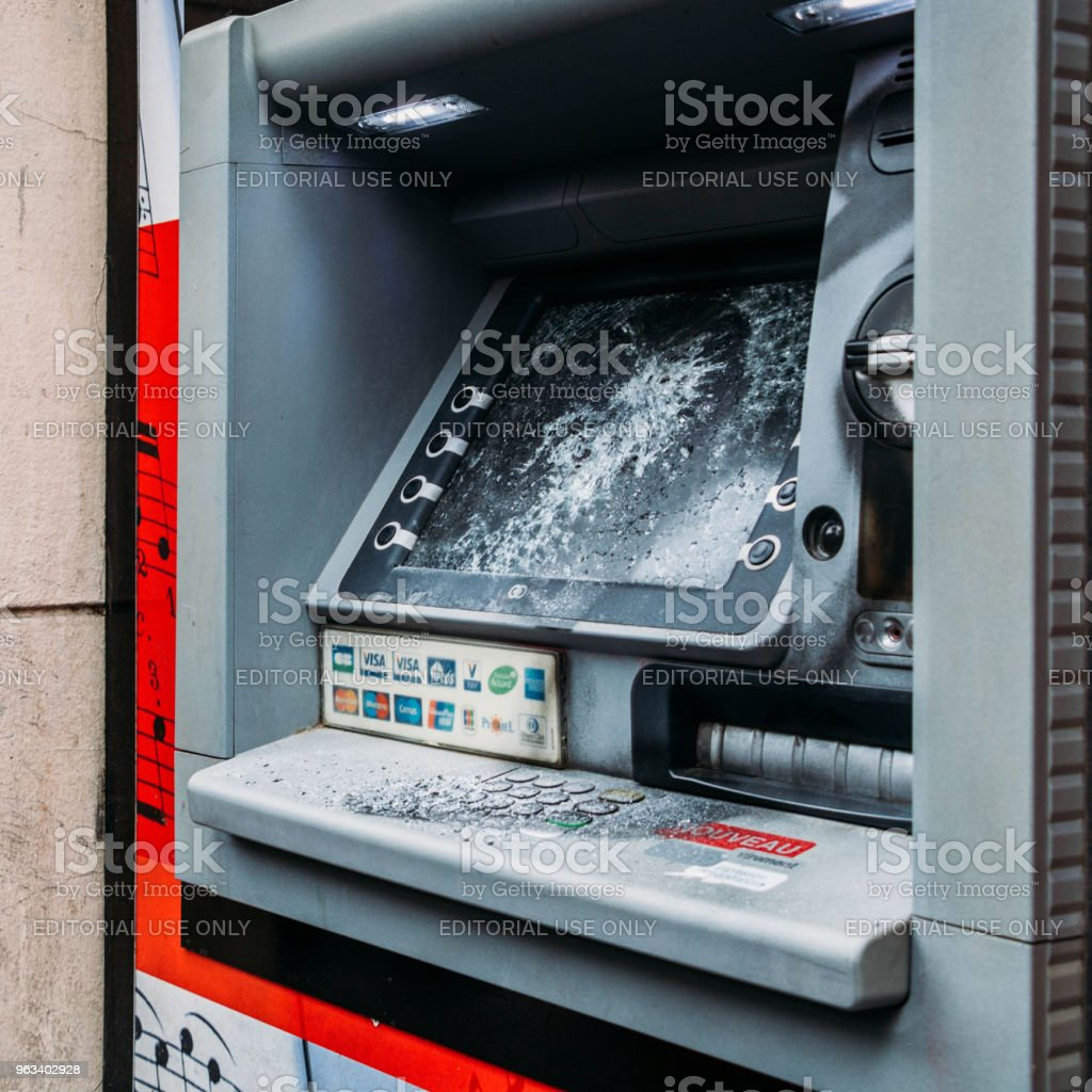 A vandalised Automatic Teller Machine in Paris following anti-government protests stock photo