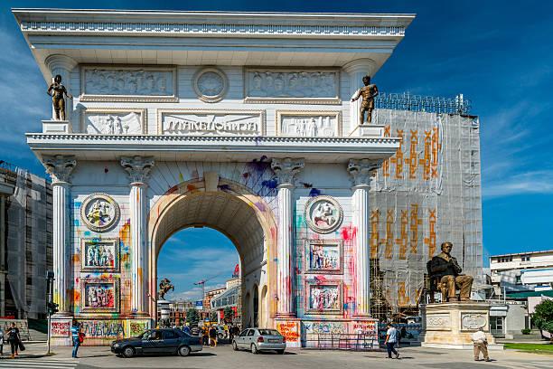 vandalism on the triumphal arch in skopje. - üsküp stok fotoğraflar ve resimler