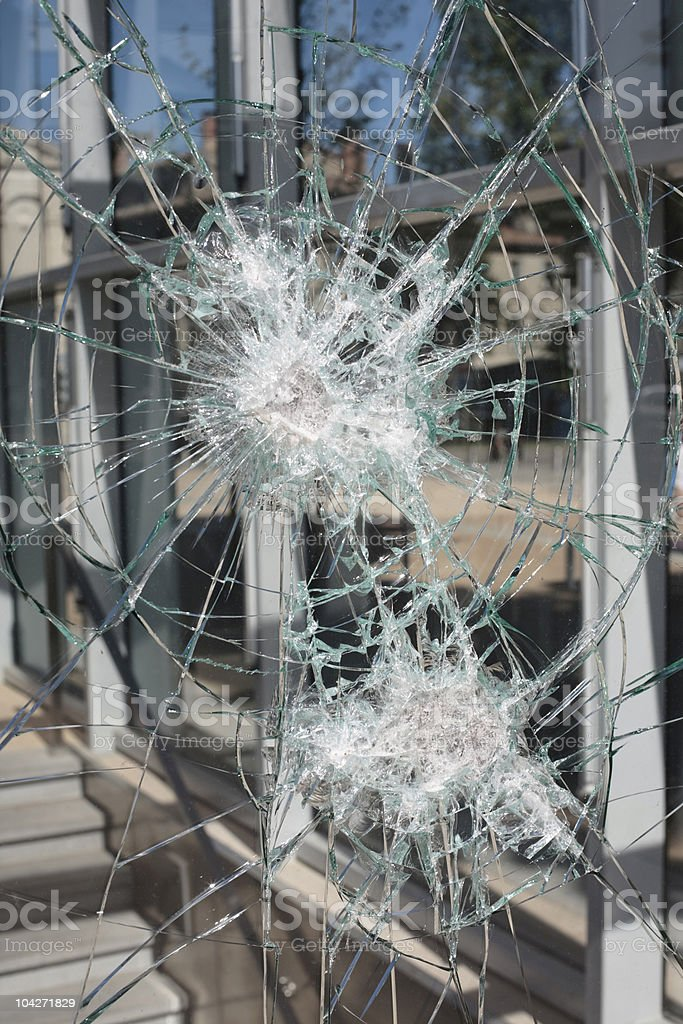 vandalism - smashed glass window royalty-free stock photo