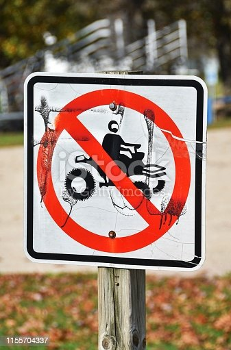 No ATV sign painted by vandals.