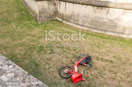 Paris, France - Sept 01, 2019: Vandalized Uber Jump electric bike thrown into the ditch of The Dome (tomb of Napoleon) - Musée de l'Armée