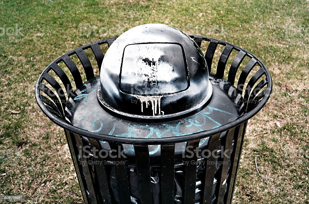 Vandalized Garbage Can royalty-free stock photo