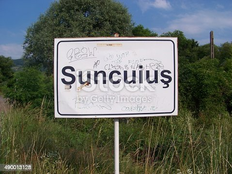 Suncuius town limit sign was vandalized. Suncuius is a small town in western Romania.