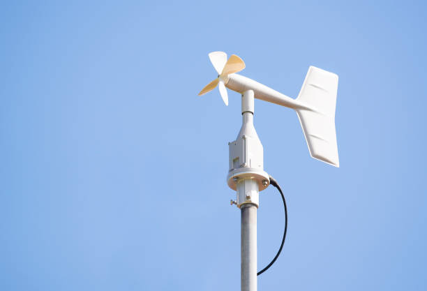 Vane style of anemometer against the blue sky. - foto stock