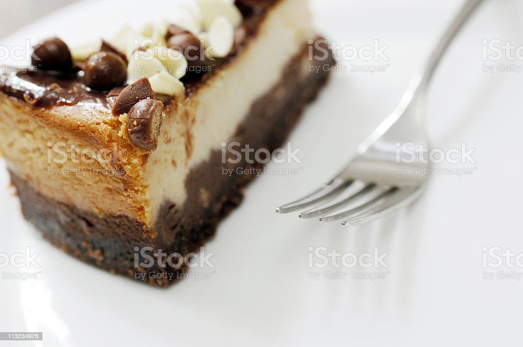 vanilla and chocolate cheesecake with fork stock photo