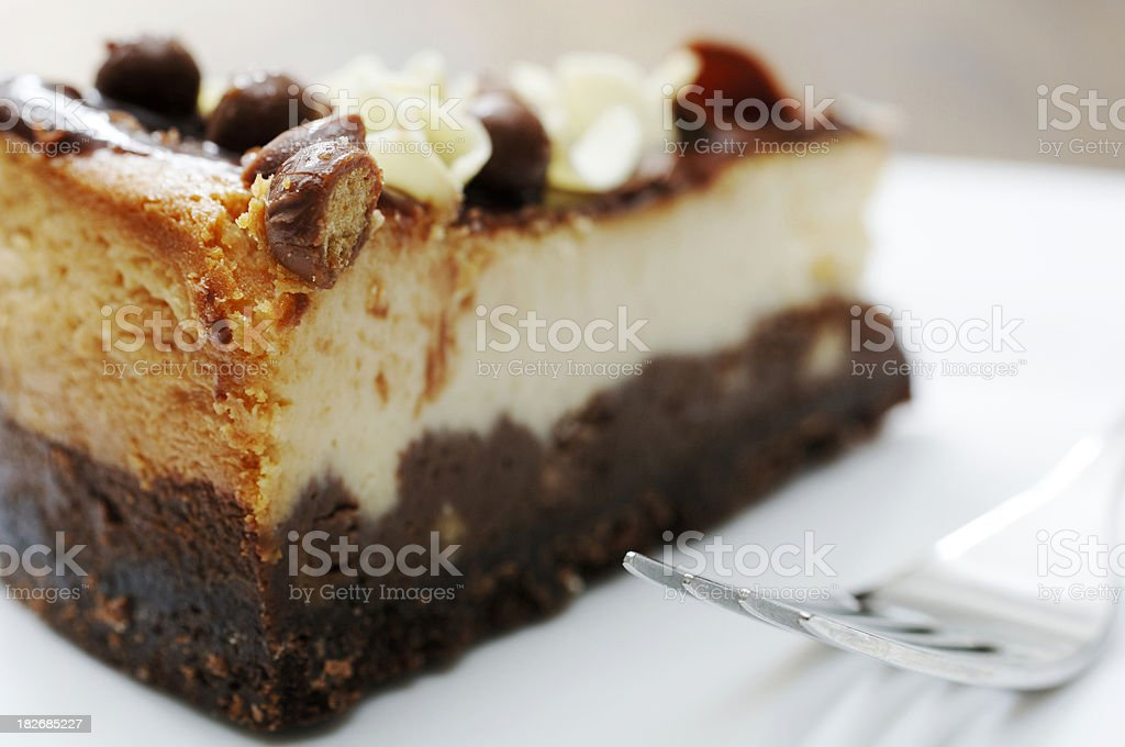 vanilla and chocolate cheesecake with fork royalty-free stock photo