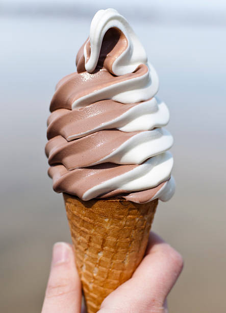 Vanilla and chocolate ice cream cone stock photo