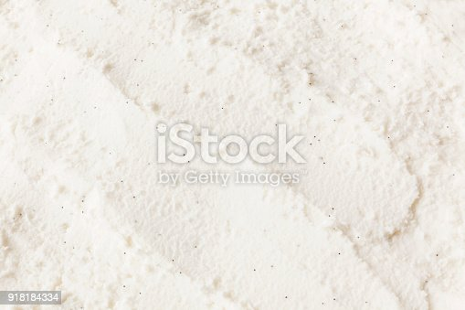 Close-up of vanilla bean ice cream texture with scoop marks