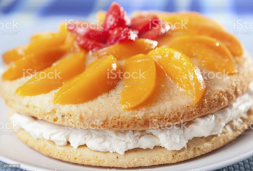Vanilla cake with peaches royalty-free stock photo