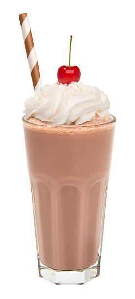 vanilla chocolate milkshake with whipped cream and cherry isolated - milkshake stockfoto's en -beelden