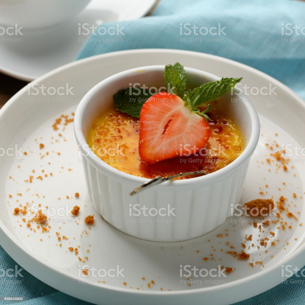 Vanilla creme brulee with berry, food closeup stock photo