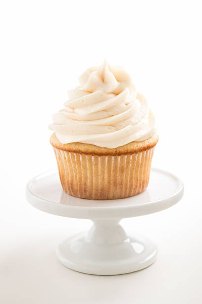 Vanilla Cupcake on a White Pedestal with Copy Space stock photo