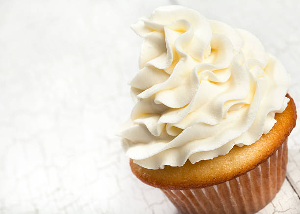 Vanilla Cupcake Gourmet vanilla cupcake with butter cream frosting. buttercream stock pictures, royalty-free photos & images