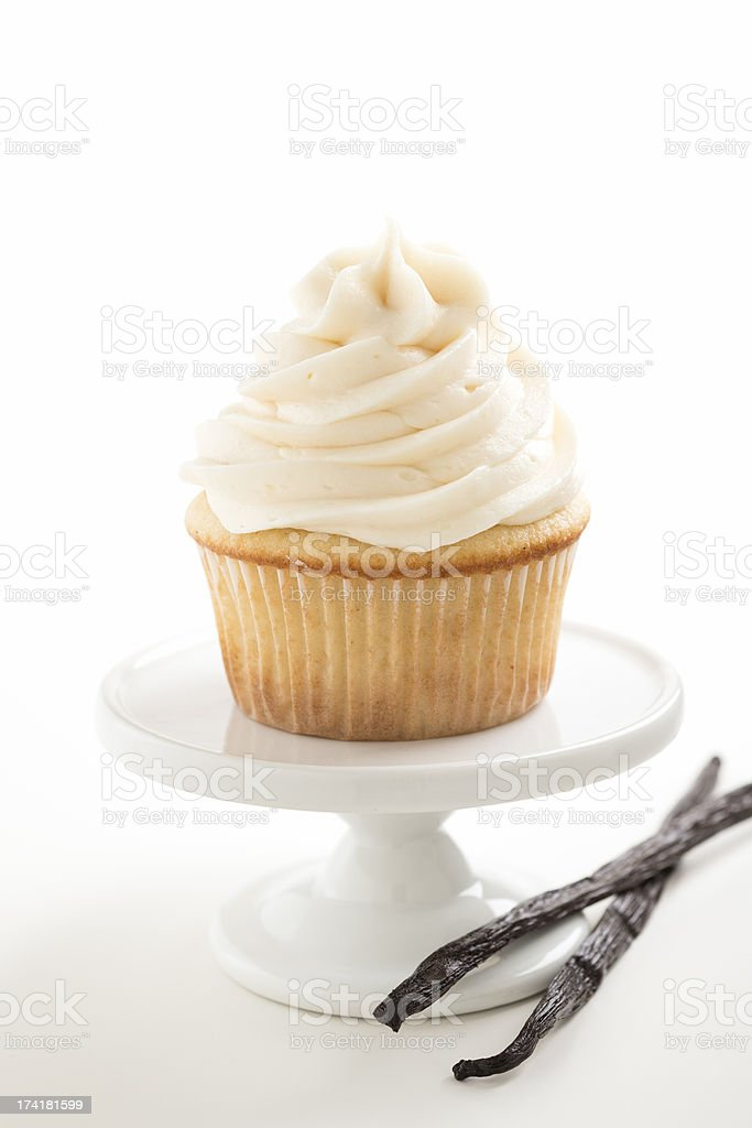 Vanilla Cupcake with Beans on a White Pedestal stock photo