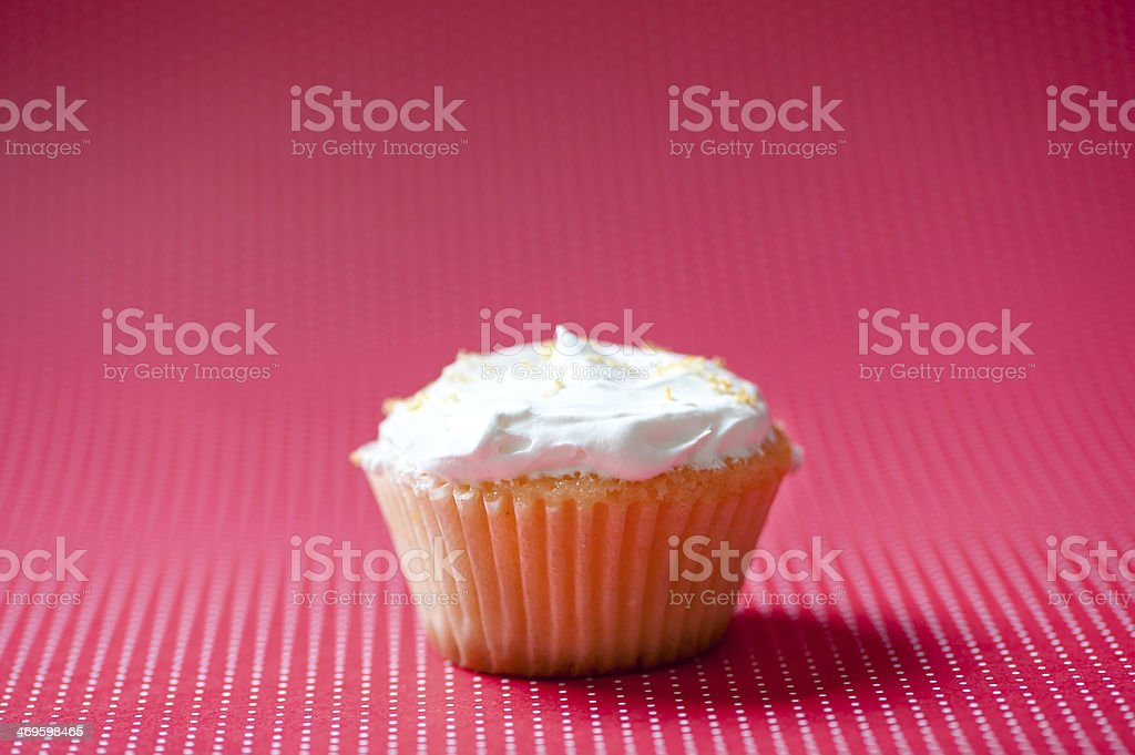 Vanilla cupcake with cream topping and crunchy cookies royalty-free stock photo