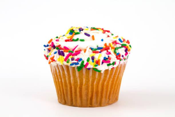 Vanilla cupcake with sprinkles stock photo
