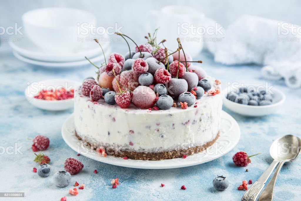 vanilla ice cream cake with frozen berries stock photo
