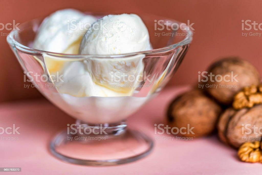 Vanilla ice cream in bowl and walnuts - Royalty-free Archival Stock Photo