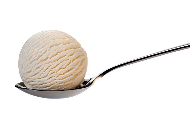 Vanilla ice cream on spoon stock photo