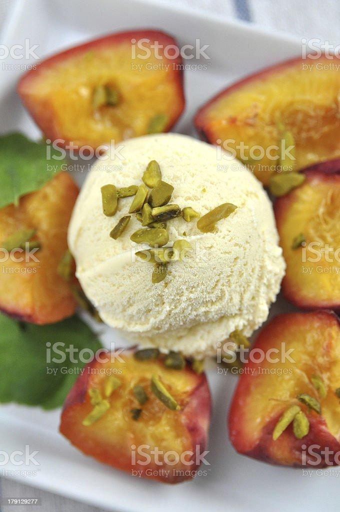 Vanilla Ice Cream with Peach and pistachio royalty-free stock photo