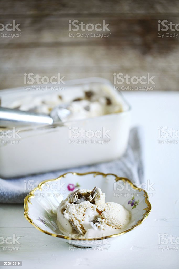 Vanilla ice cream with truffles, homemade in a rustic bowl stock photo