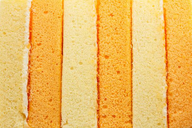 vanille orange chiffon kuchen struktur - biskuitboden stock-fotos und bilder