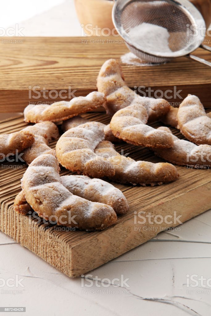 Vanille Kipferl cookies for christmas on brown wood with sugar stock photo