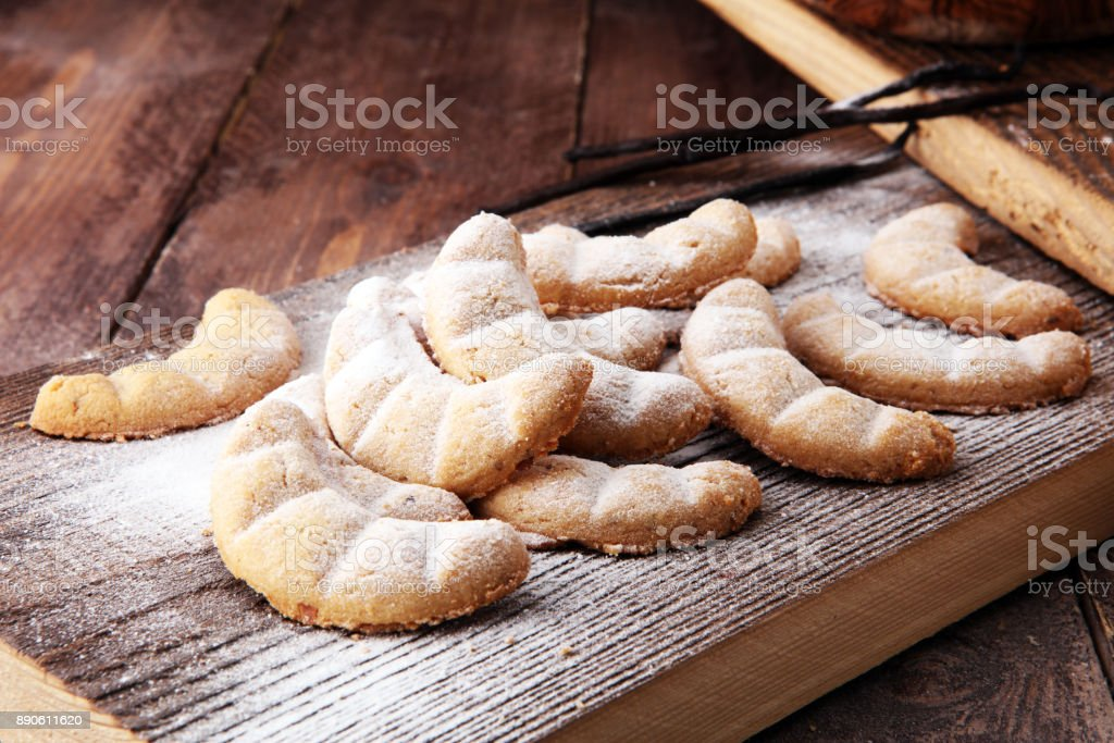 Vanille Kipferl cookies for christmas on brown wooden table with sugar stock photo