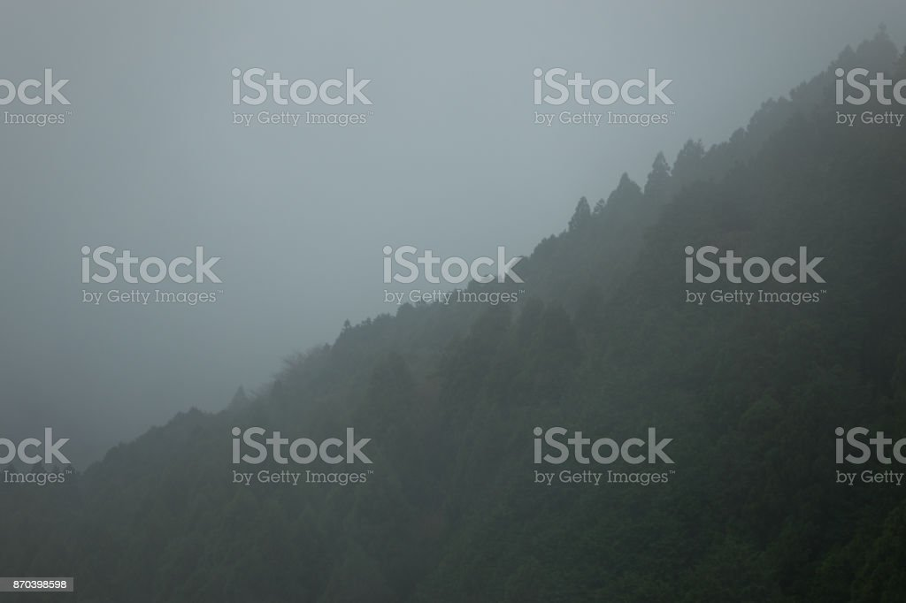 Vanishing mountains in the Fogs stock photo