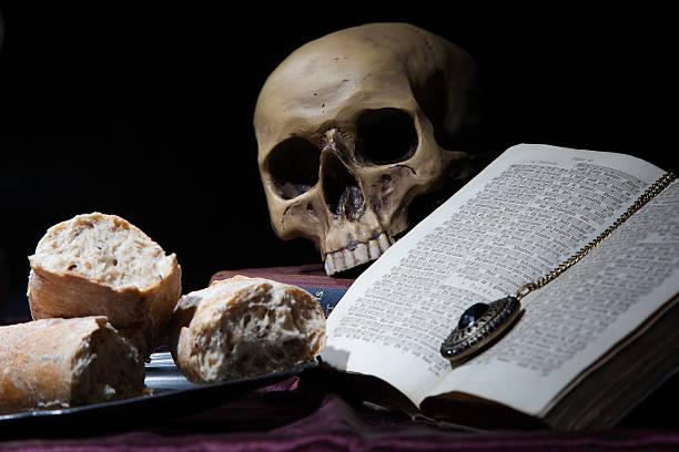 vanitas skull and bread stock photo